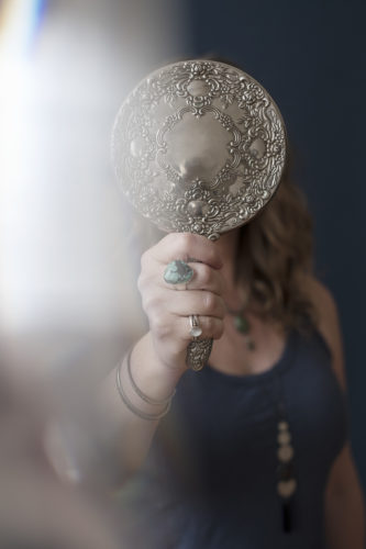Holding a silver mirror