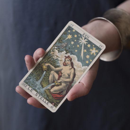 Holding a tarot card